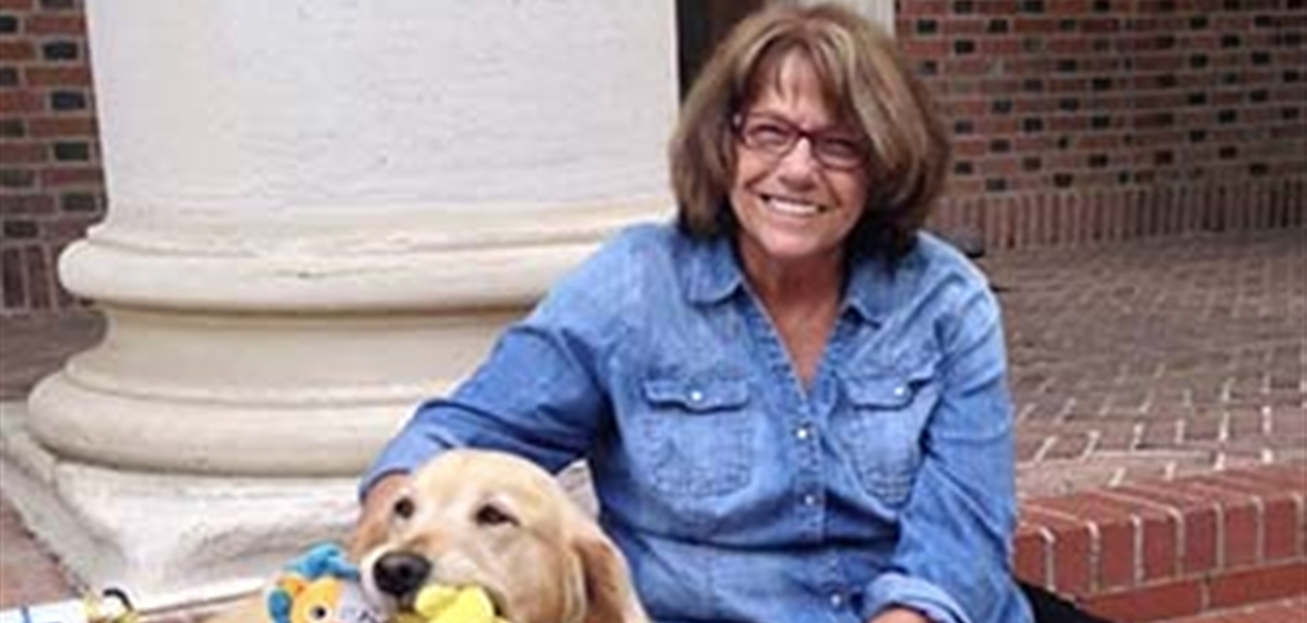 Barbara King and her dog outside of Frandsen Humanities Building