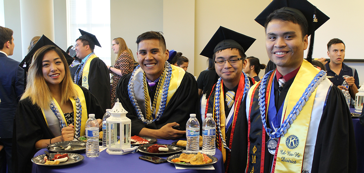 Four graduates at the Asian American and Pacific Islander Graduate Celebration