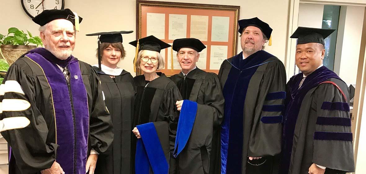 Judicial Studies Graduates in formal commencement hoods