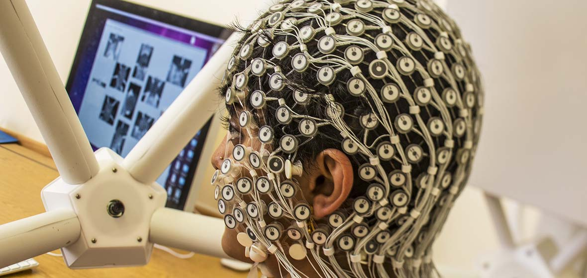 Integrative Neuroscience research shows person with HD EEG technology on head