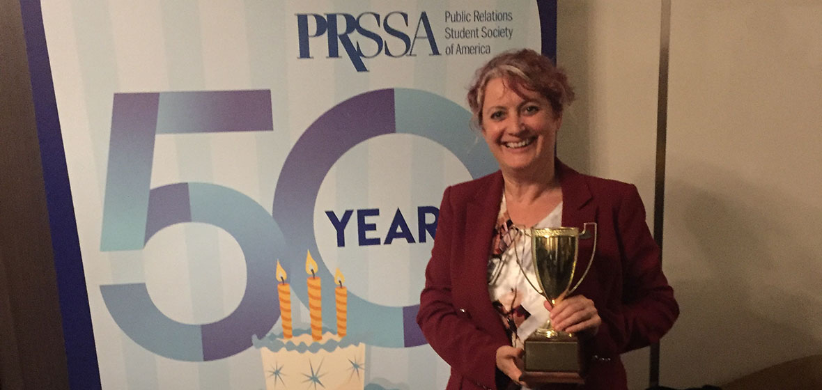 Alison Gaulden poses with her award at the national PRSSA Conference in Boston, MA.