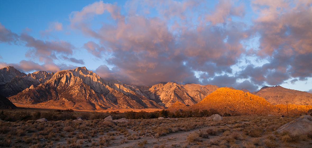 Sierra Nevada mountain range with rural, uninhabited land in the foreground.