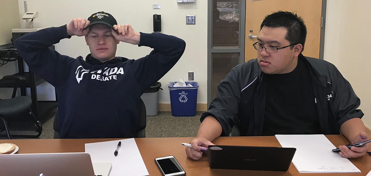 University students Josh Nelson and Sean Thai prepare for the 2018 National Debate tournaments