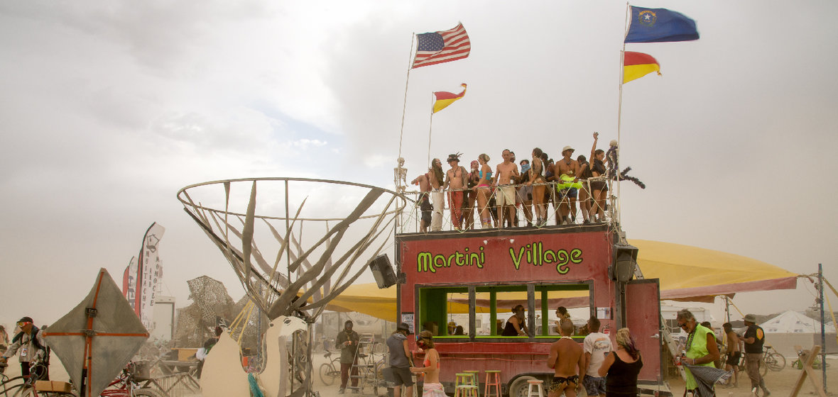 Photo of people having fun at Burning Man's Martini Village