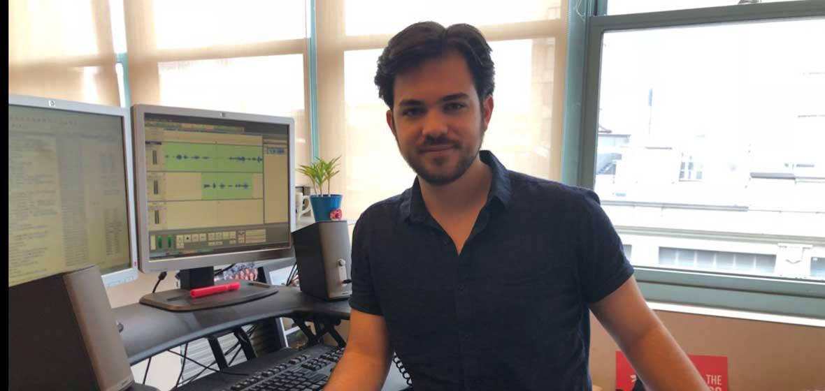 A man stands at a desk.