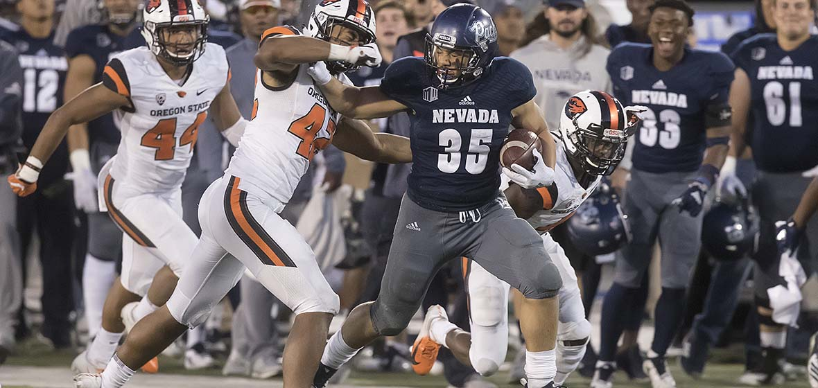 Nevada Wolf Pack Football running back Taua Toa runs past players of the Oregon State Beavers during a game Sept. 15, 2018, played at Mackay Stadium in Reno