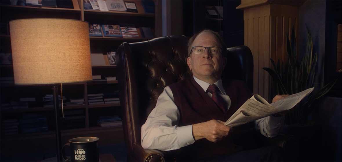A man sits in an armchair.