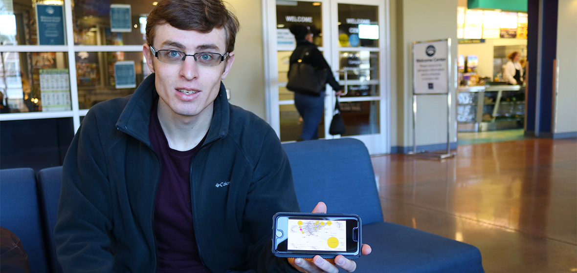 Student Michael Walecke holding photo with picture of data