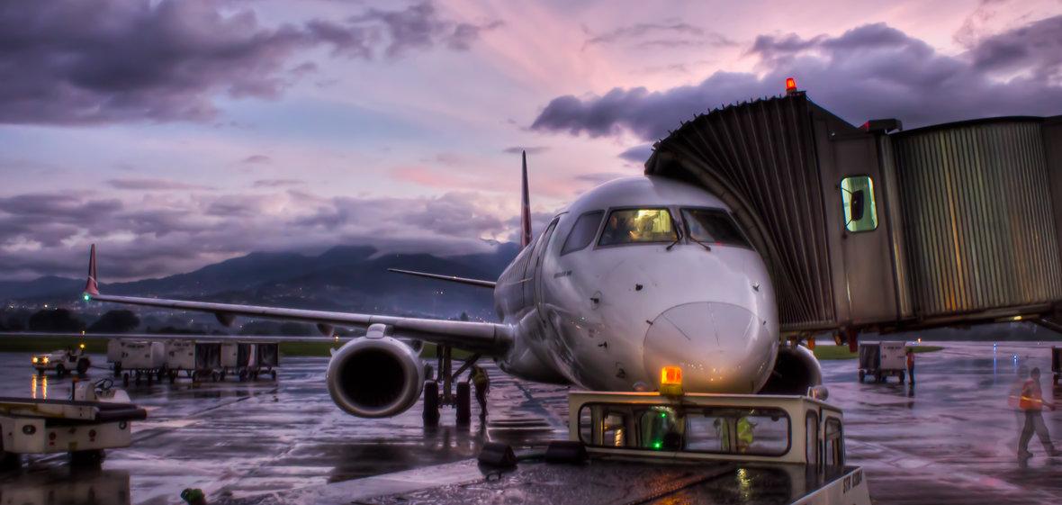 Airplane on tarmac at sunrise
