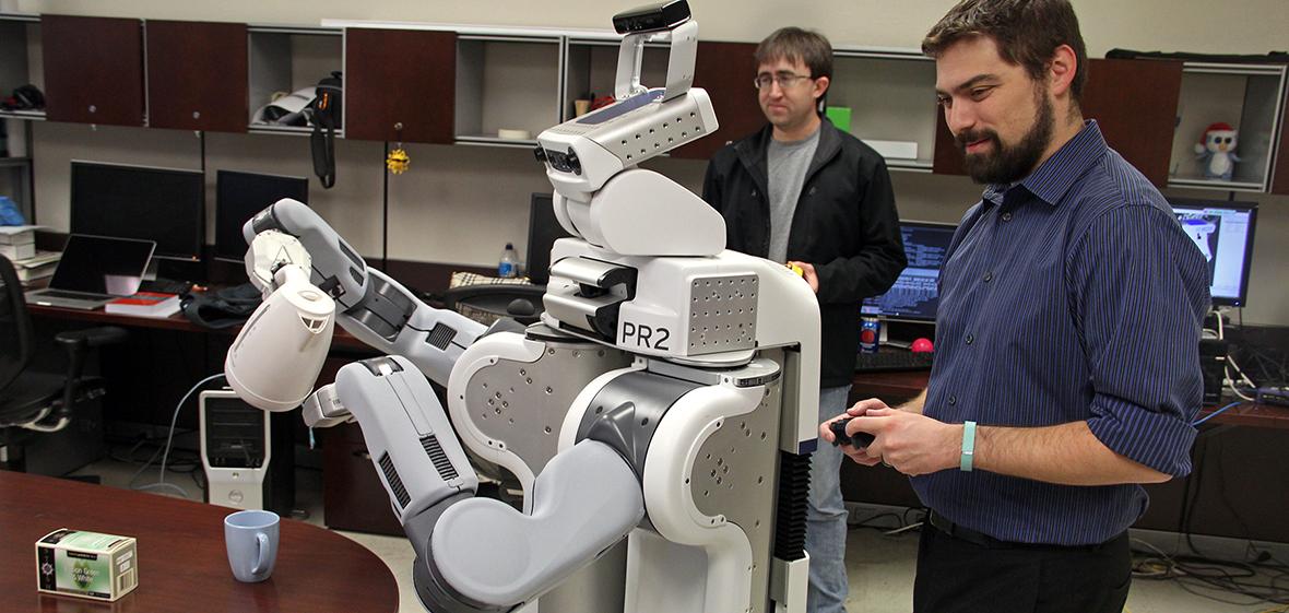 David Feil-Seifer with PR2 robot