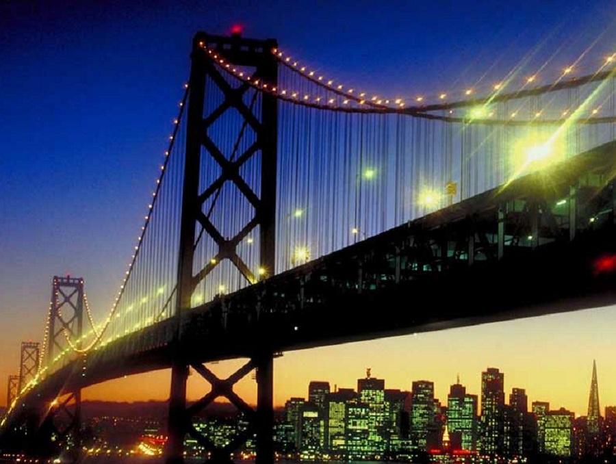 Golden Gate Bridge at night with city lights