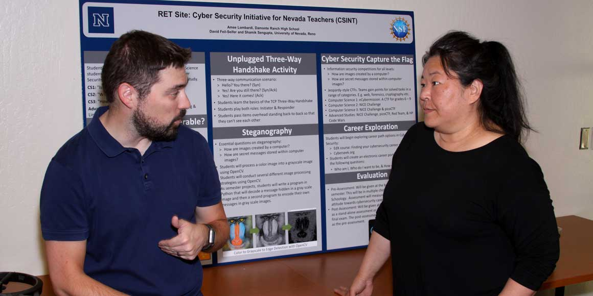 Dave Feil-Seifer and Amee Lombardi in front of her poster