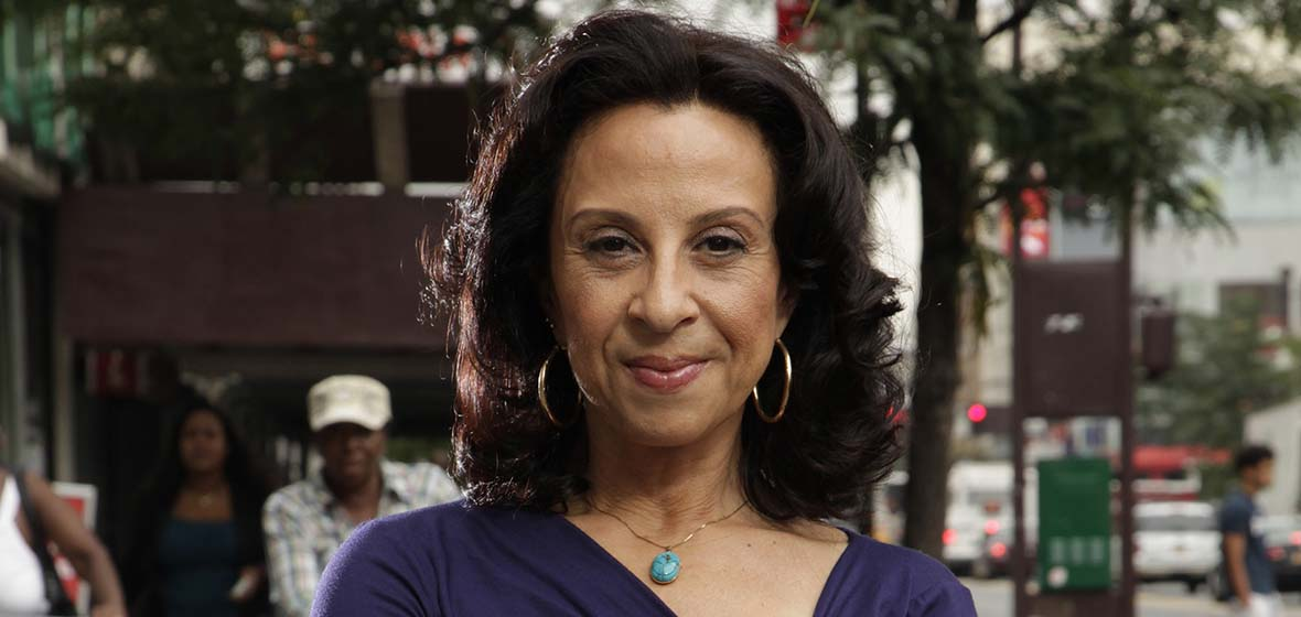 Maria Hinojosa poses for photograph outside
