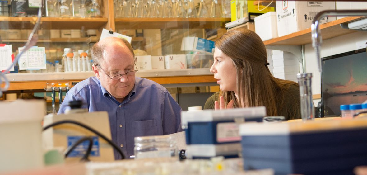Professor Jeff Harper with a student in his biochemistry lab
