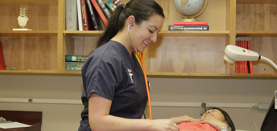 University student Shawnice Kraeber working on a patient at the Student Outreach Clinic
