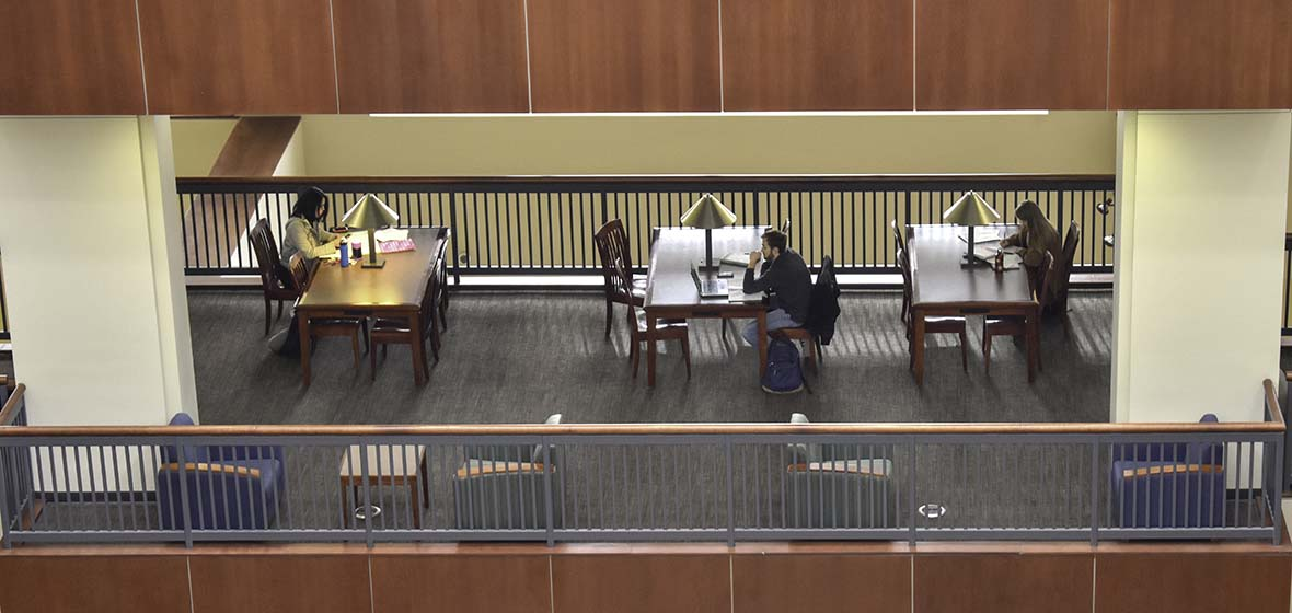 Three table sets of students study in the Mathewson-IGT Knowledge Center at the University of Nevada, Reno