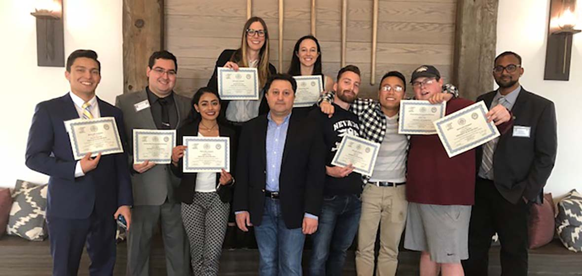 University of Nevada, Reno students pose for a photo each showing their winning certificate after the 2018 Model Arab League competition