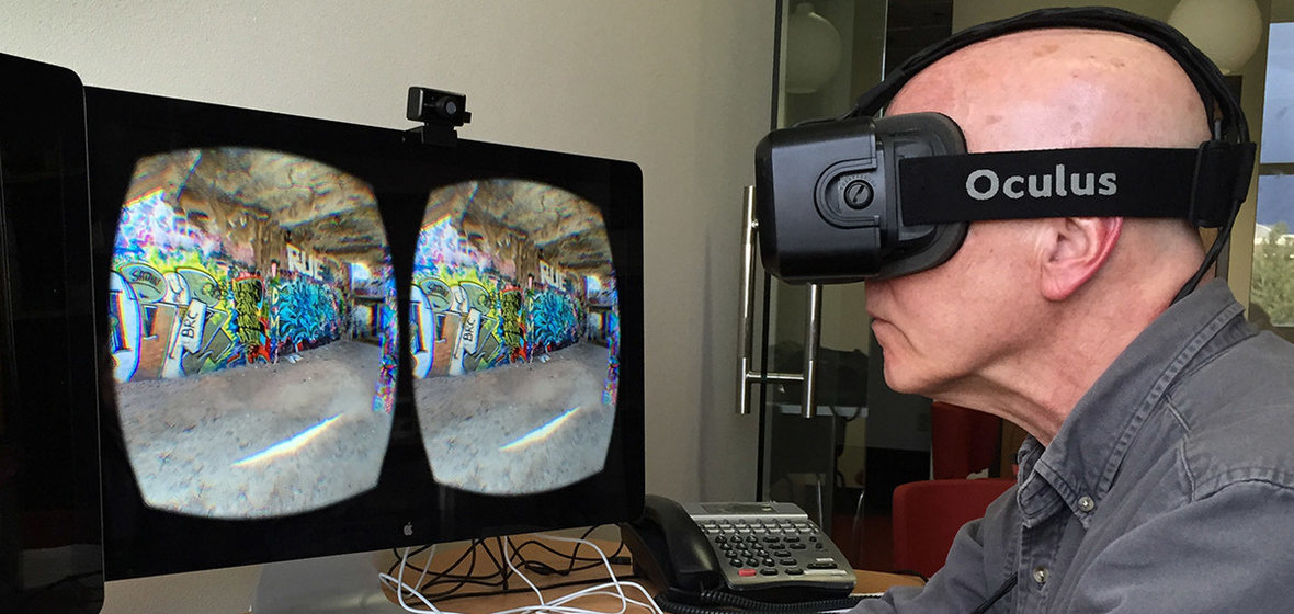Howard Goldbaum uses an Oculus VR headset with a computer monitor displaying what he sees