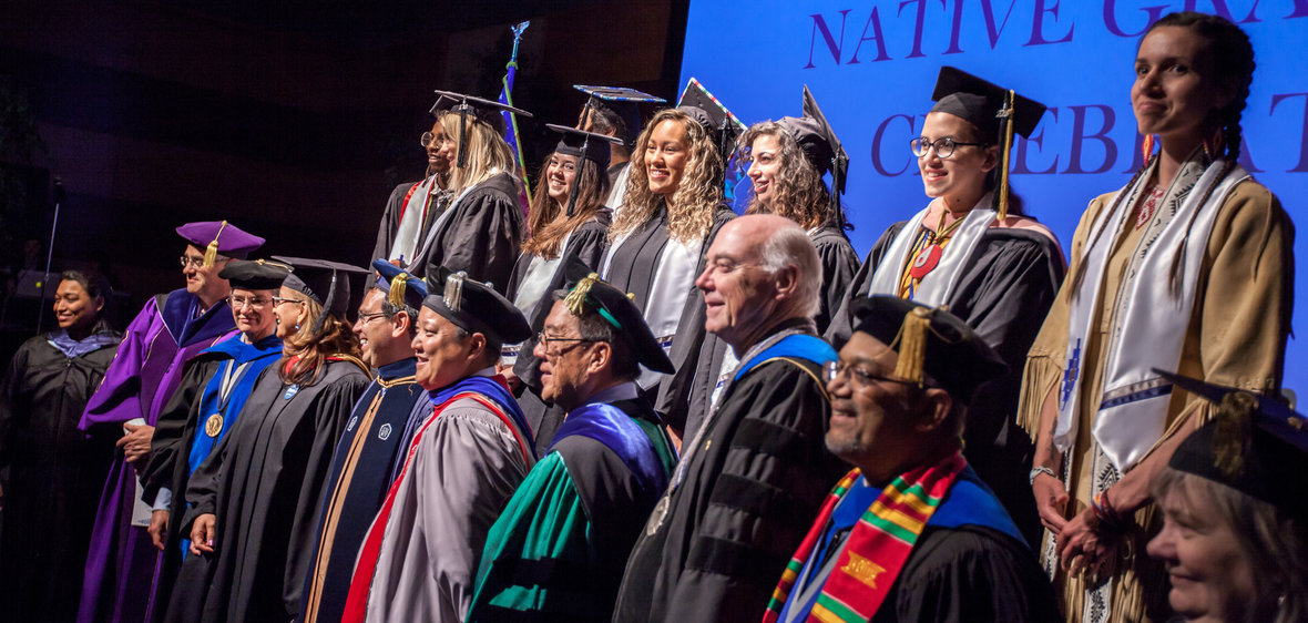 Graduates and faculty members gathered at the American Indian & Alaskan Native Graduate Celebration
