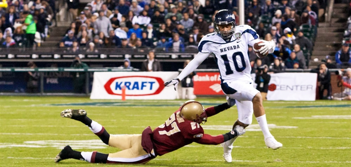 Colin Kaepernick runs with the ball