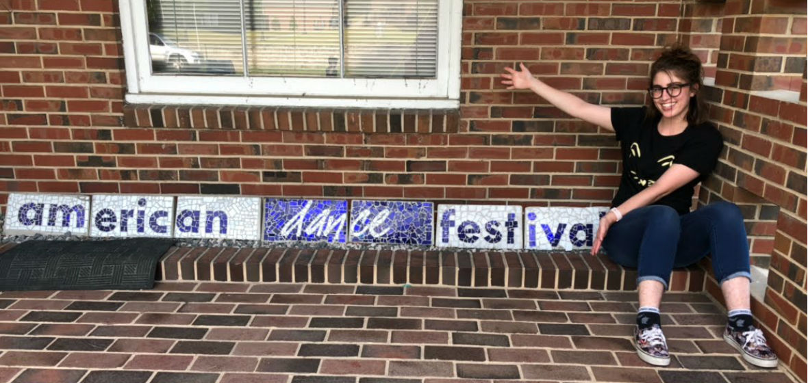 Noelle Ruggieri next to an American Dance Festival sign