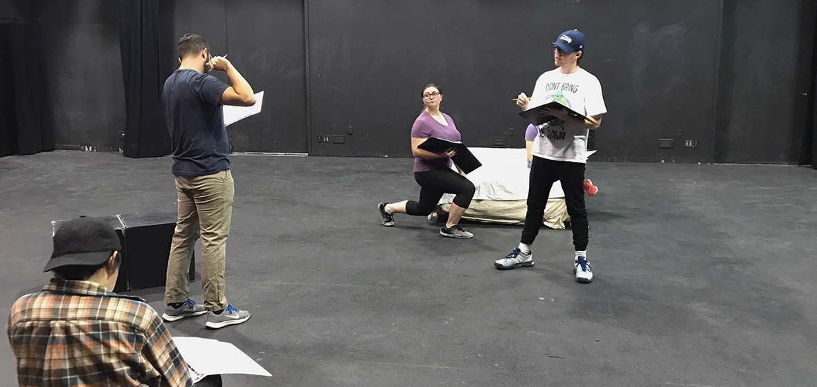 """The cast and director of """"A Free Man"""" rehearse."""
