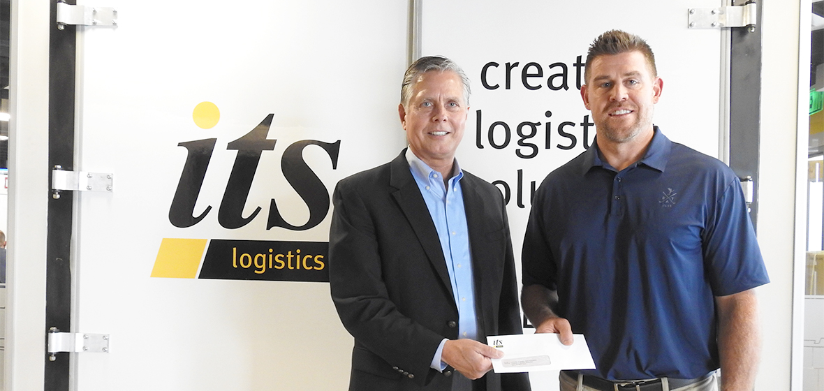 Dean Greg Mosier and ITS Logistics President Mike Crawford in front of ITS Logistics