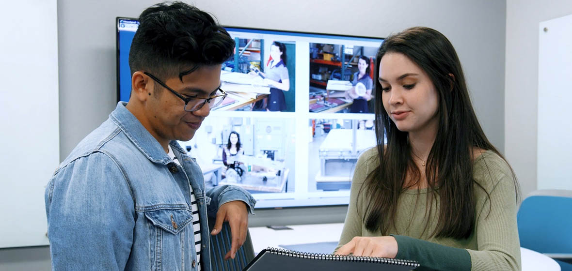 Two students working in the Ozmen Center for Entrepreneurship