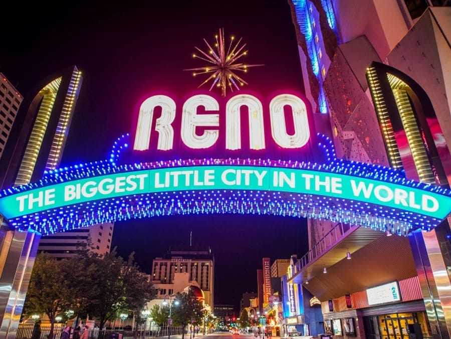 The Reno arch lit up at night