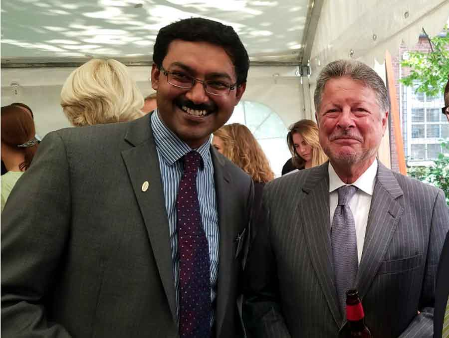 Subramanian with Fulbright Ambassador Charles C. Adams, Jr., smiling for the camera at an awards reception.