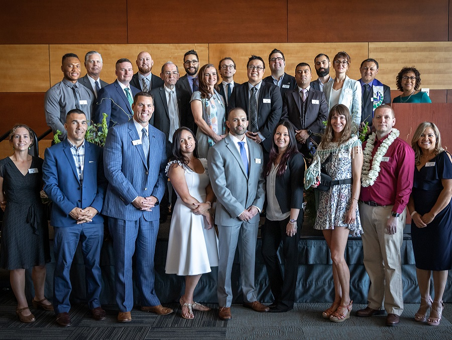 The EMBA program's 2019 graduates lined up in two rows and dressed nicely for the photo oppotunity