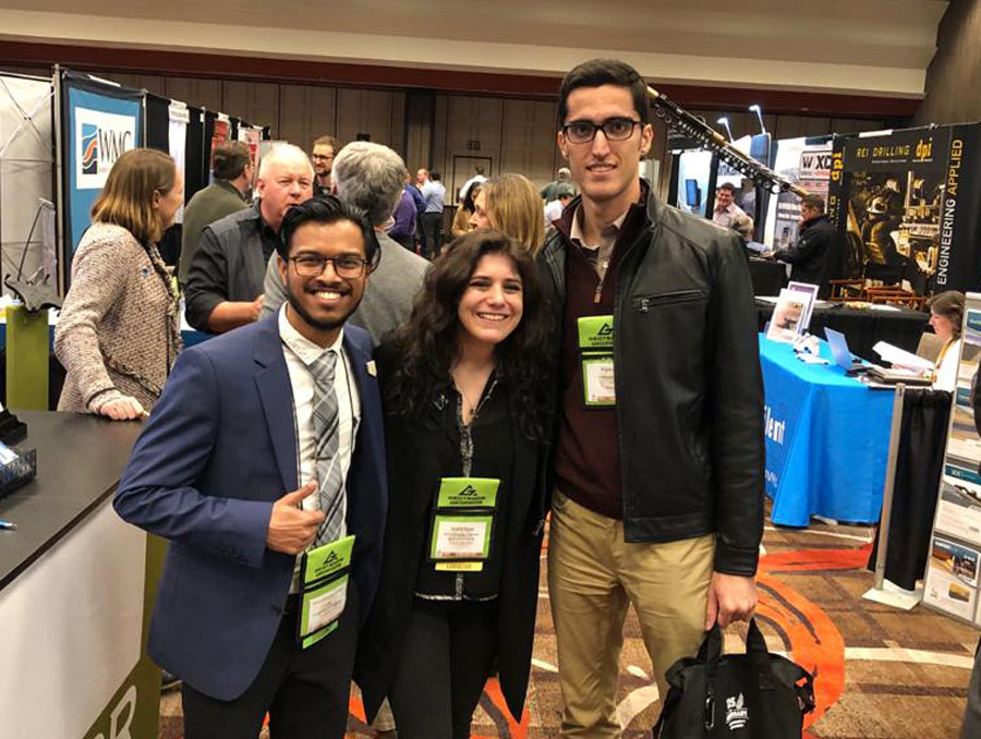 Himesh Patel (left) stands with Society of Mining Engineers Young Leaders Emily Rose and Bijan Peik.