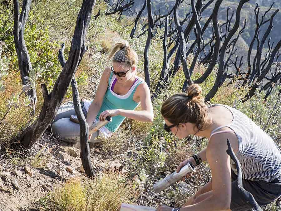 Erin Hanan and student taking soil samples