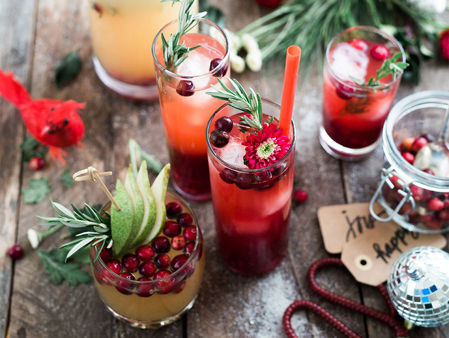 Drinks made with fresh fruit on a table decorated for the holidays