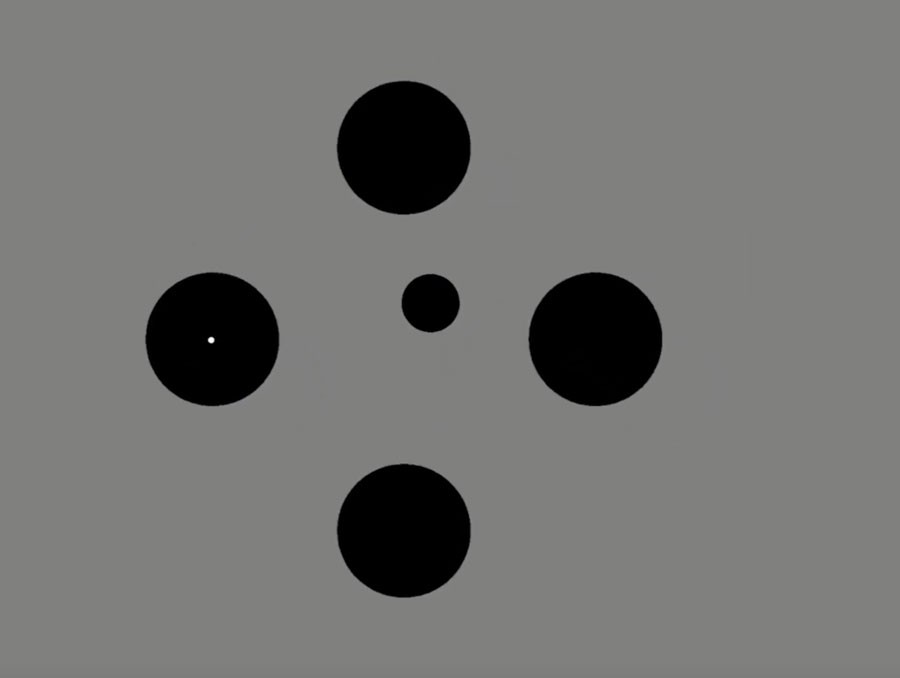 Four larger black dots surrounding a smaller black dot with a smaller white dot in the center.