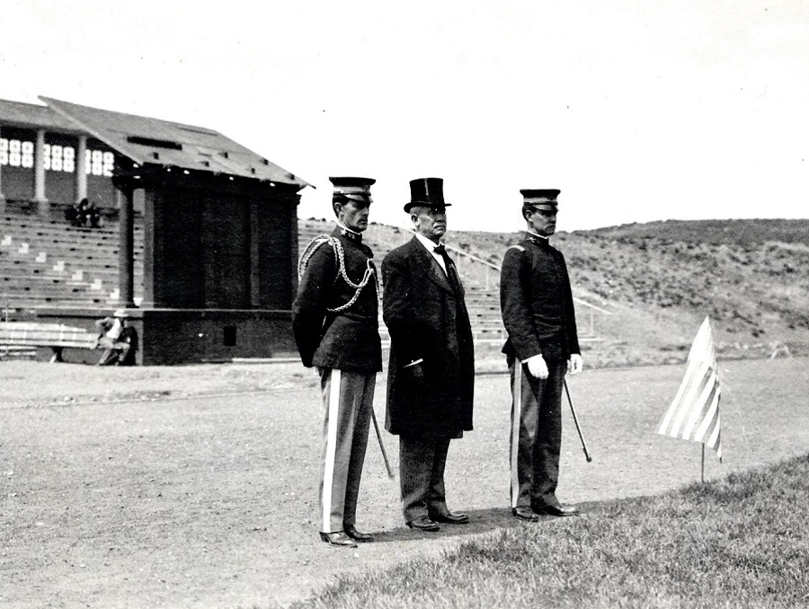Third president of the university, University President Joseph Edward Stubbs (president from 1894-1914) stands on Mackay Field with two other men in military uniforms.