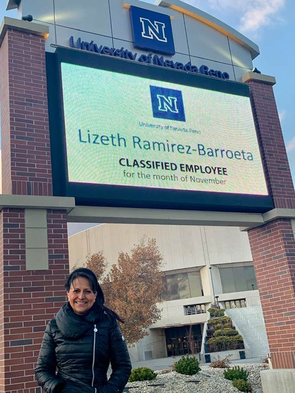 "Lizeth under the Lawlor sign which says ""Lizeth Ramirez-Barroeta, classified employee for the month of November."