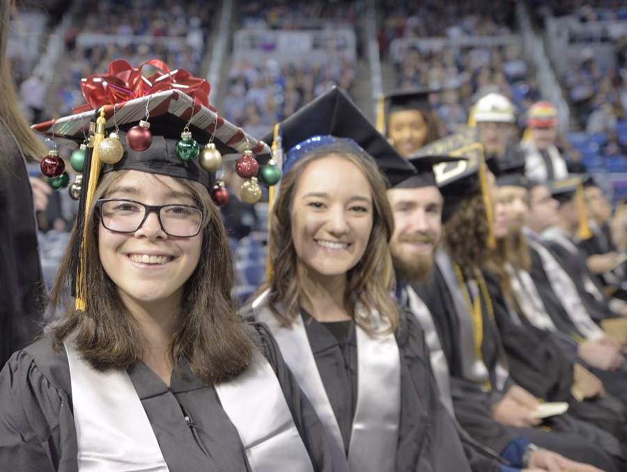 Graduates smiling at the 2019 Winter Commencement –