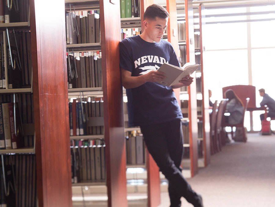 Student reading a book in the Knowledge Center