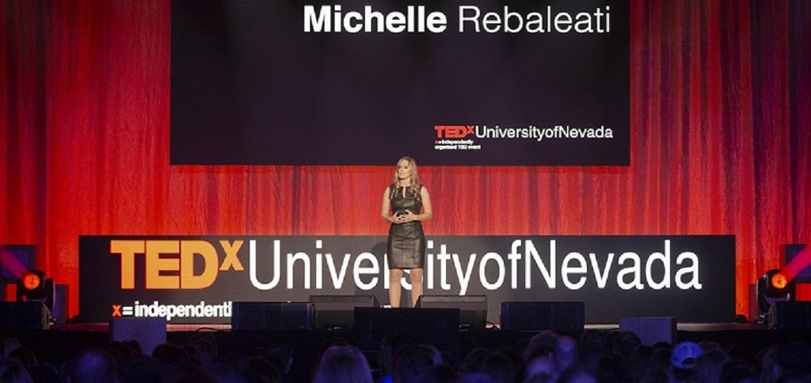 Michelle Rebaleati on the 2019 TEDxUniversityofNevada stage.