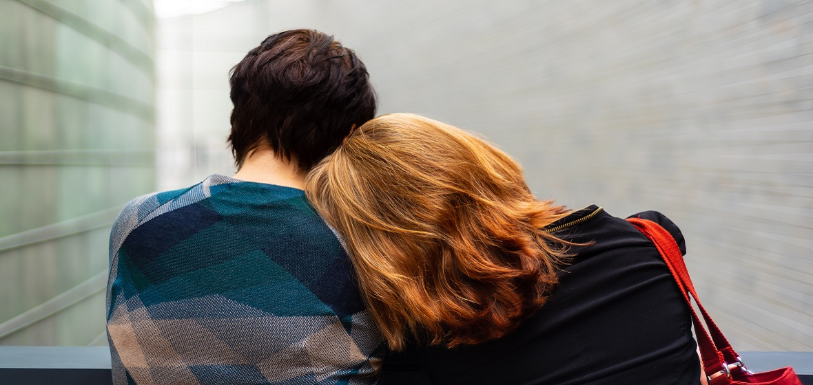 A couple posing romantically from behind
