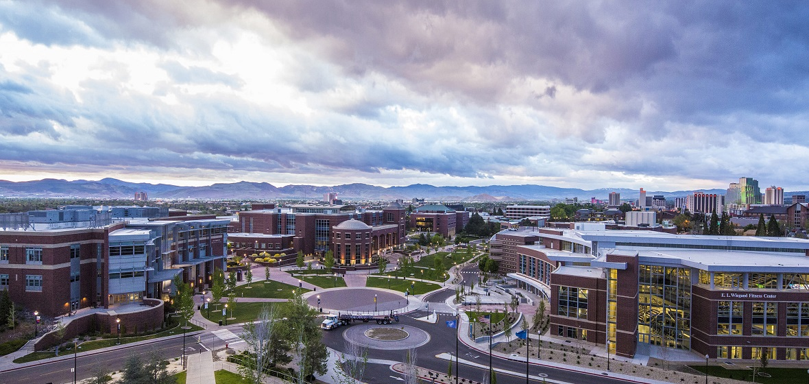 The campus at sunrise as viewed from the top of Lawlor Events Center looking south.
