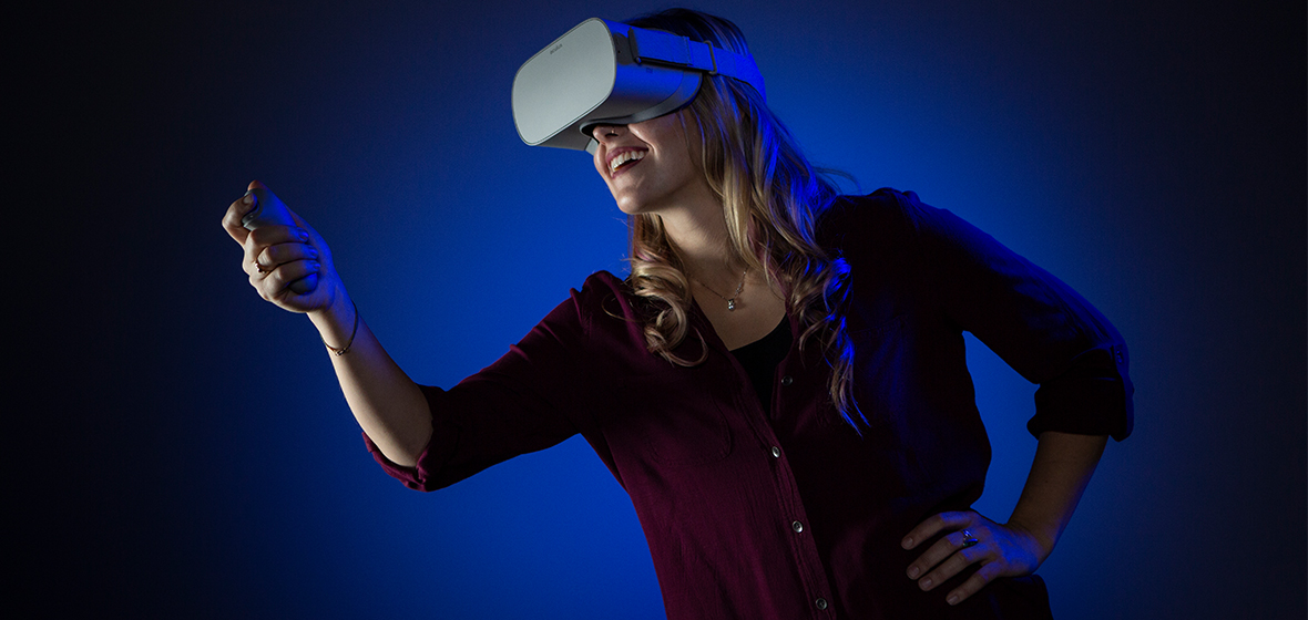 Multimedia Production Specialist Michelle Rebaleati teleports herself to a different environment using virtual reality