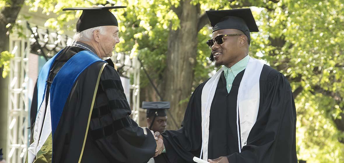 President Marc Johnson and Malik Reed
