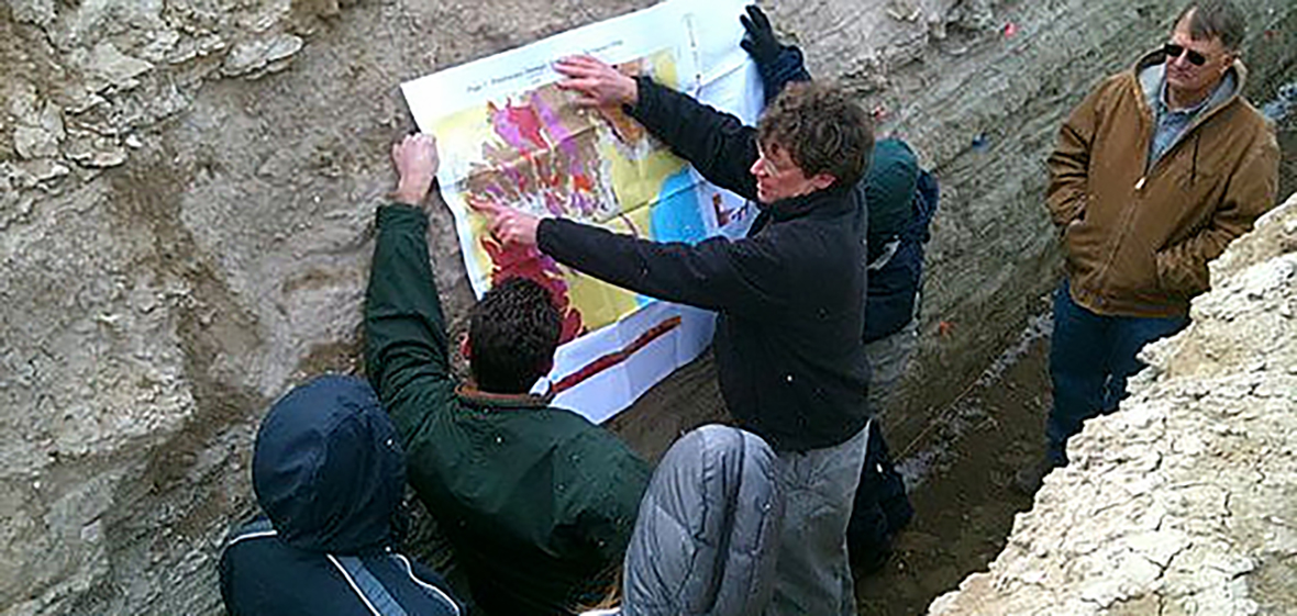 teaching geothermal class in a trench