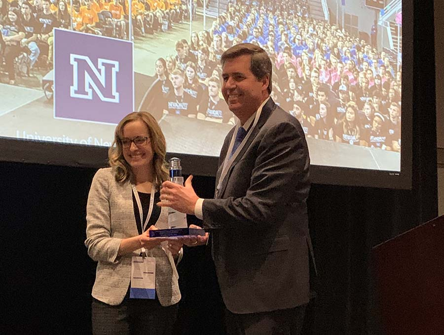 Felicia DeWald is presented with an award by Thayne McCulloh, president of Gonzaga University and vice chair of the Northwest Commission on Colleges and Universities.