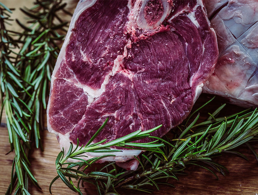 Steak on a cutting board with herbs