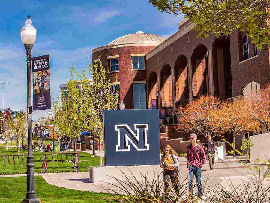 Nevada logo on campus with Mathewson-IGT Knowledge Center in background