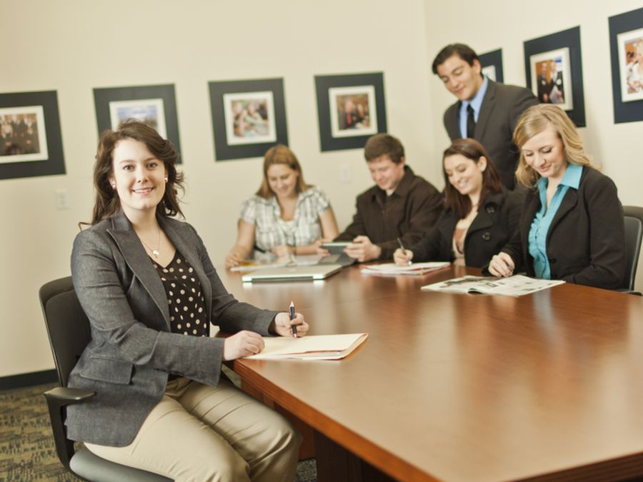 A group of business people around a conference table