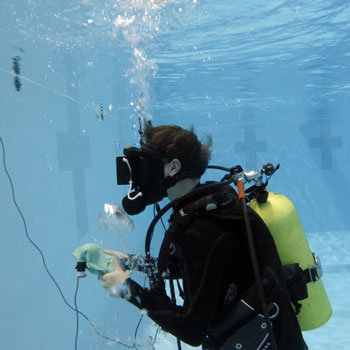 Participant scuba dives with a VR headset to simulate zero gravity on the International Space Station